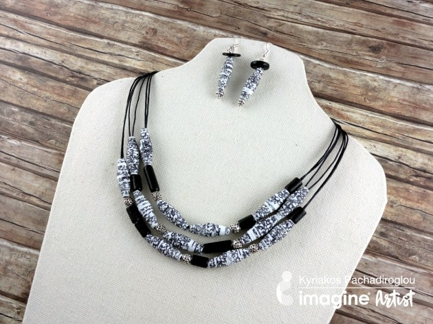 Handmade necklace and earrings featuring handmade black and white paper beads by Kyriakos Pachadiroglou of The Crafters World.