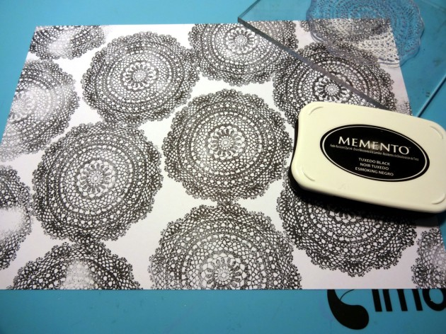 using the Memento Tuxedo Black inkpad I choose a large acrylic stamp that looks like lace.