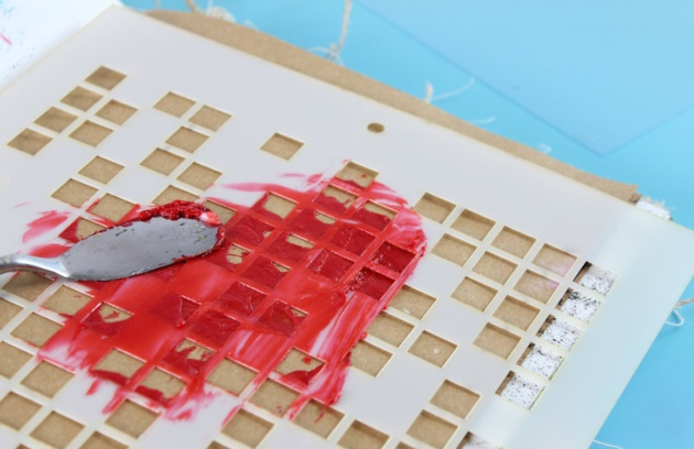 Apply the colored paste through a stencil onto craft paper and leave to dry