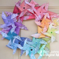 See How to Make a Paper Rainbow Pinwheel Wreath