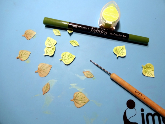 VersaMagic DewDrop Key Lime and the Fabrico Marker. Use a stylusto shape the leaves into a more realistic look.