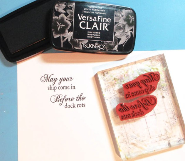 Stamp the phrase on white cardstock with VersaFine Nocturne ink