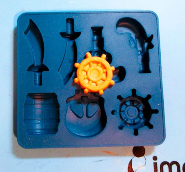 Create a ship's wheel from Makin's tan clay with a pirate mold
