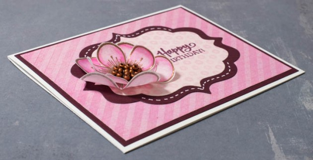 On this card the background is heat-embossed also, using clear embossing powder.