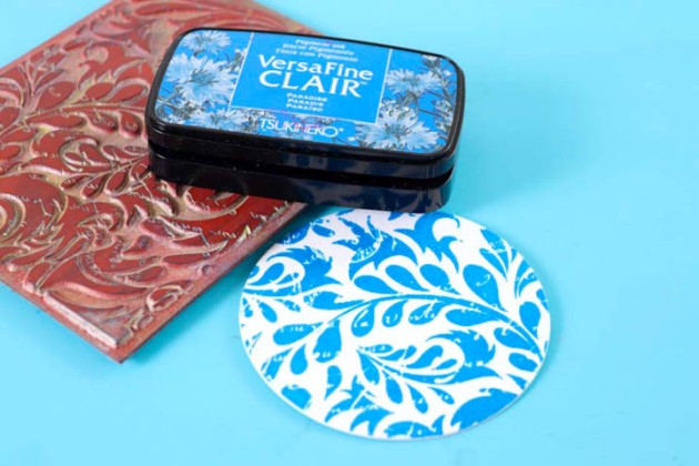 Stamp a background image onto white cardstock using VersaFine Clair in Paradise