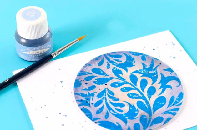 Use a small paintbrush and All-Purpose Ink in Sky Mist