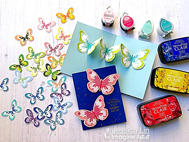 Handmade cards featuring colorful butterflies stamped in multiple layers with Tsukineko inks.