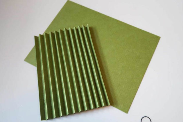 "Create the accordion side panels by creasing a 4"" x 4 ¼"" card panel at ¼"" increments."