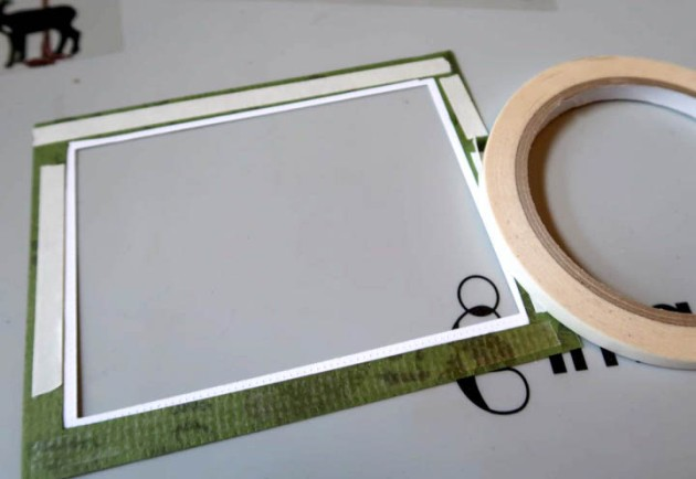 Use Tear It Tape to affix the front acetate panel to the card frame.